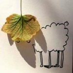 الرسم بالظل قام فنان باستخدام الظل لاكمال لوحاته