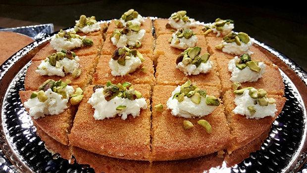 header image Article Main Fustany basbousa Recipe sally fouad AR طريقة عمل البسبوسة الطرية من مطبخ سالي فؤاد